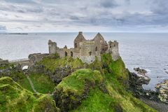 Dunluce Castle, County Antrim, Ireland. Dunluce Castle is a now-ruined medieval castle in Northern Ireland. It is located on the edge of a basalt outcropping in Royalty Free Stock Photos