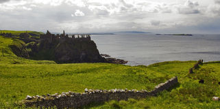 Dunluce Castle North Antrim coast. Dunluce Castle built on a headland that drops straight into the sea along the North Antrim coast. The castle dates back to the stock photos