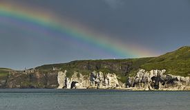 Dunluce Castle in Northern Ireland. Dunluce Castle, County Antrim, under a beautiful rainbow stock photos