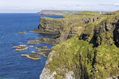 Dunluce Castle, Northern Ireland. Dunluce Castle Irish: Dun Libhse, a now-ruined medieval castle located on the edge of a basalt outcropping in County Antrim royalty free stock image