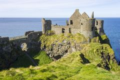 Dunluce Castle, Northern Ireland. Dunluce Castle Irish: Dun Libhse, a now-ruined medieval castle located on the edge of a basalt outcropping in County Antrim royalty free stock photography
