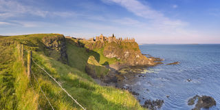 Dunluce Castle in Northern Ireland on a sunny morning Royalty Free Stock Photos