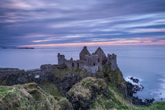 Dunluce Castle, Northern Ireland. Sunset at Dunluce Castle on the north coast of Ireland Royalty Free Stock Photos
