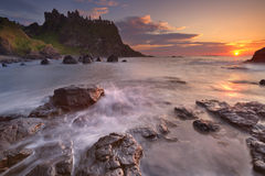 The Dunluce Castle in Northern Ireland at sunset Royalty Free Stock Photos