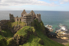 Dunluce Castle. Is a now-ruined medieval castle in Northern Ireland. It is located on the edge of a basalt outcropping in County Antrim and is accessible via a Stock Images