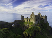 Dunluce Castle and some islands off the coast of Northern Ireland. Dunluce Castle and some remote islands off the coast of Northern Ireland on a beautiful sunny Royalty Free Stock Images