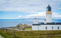 Dunnet Head Lighthouse, in Caithness, on the north coast of Scotland, the most northerly point of the mainland of Great Britain. Royalty Free Stock Photos