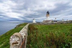 Dunnet Head lighthouse on Pentland Firth, Scotland on a cloudy day