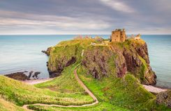 Dunnottar Castle Headland. Dunnottar Castle is a ruined medieval fortress located upon a rocky headland on the north east coast of Scotland, near Stonehaven Royalty Free Stock Photo