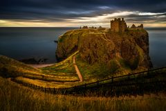 Dunnottar Castle sunset. Dunnottar Castle on high cliffs in sunset light, Scotland Royalty Free Stock Image