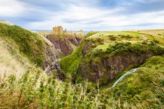 dunnottar castle and hits landscape at sunset scotland united kingdom stock image