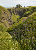 Dunnottar castle ruins in scottish coastline. Stonehaven. Scotla Stock Images
