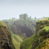 Dunnottar castle shrouded in myst. Dunnotar, Scotland - September 17, 2014: Dunnottar castle in Stonehaven, near Aberdeen, Scotland. The ethereal and evocative Stock Photography