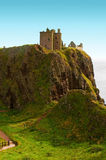 Dunnottar castle stone haven. Dunnottar castle on a cliff vovered with grass Royalty Free Stock Image