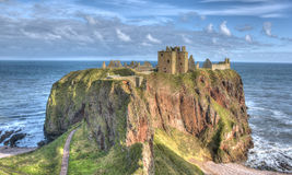 Dunnottar Castle, Stonehaven, Scotland. Dunnottar Castle, Stonehaven in Scotland. The castle sits in the water perched on the rock Royalty Free Stock Images