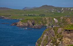 Dunquin bay and coast. Landscape of coast of Dingle and ferry enterring Dunquin harbour and bay, Dingle Peninsula, Ireland Stock Photography