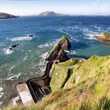 Dunquin pier and blasket islands. The tiny Dunquin pier is located in front of the Blasket islands Dingle peninsula, co Kerry, Ireland Royalty Free Stock Images