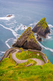 Dunquin pier. Dunquin meaning `Caon`s stronghold`, is a Gaeltacht village in west County Kerry, Ireland. Dunquin lies at the most westerly tip of the Dingle Stock Photography