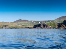 Dunquin. View to Dunquin from a fishing boat near the Slea Head on the Dingle Peninsula in Ireland with a clear deep blue sky Stock Image