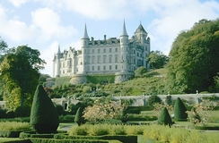 Dunrobin Castle (Scotland). The monumental Dunrobin Castle at the southeast coast of Scotland, Europe, with it's wonderful english park. This castle is the Stock Photo