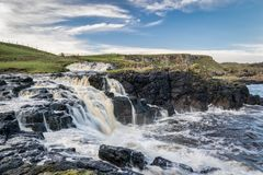Dunseverick Falls. This is Dunseverick Falls on the Antrim Coast in Northern Ireland. It is a fresh water stream that runs into the ocean. It is just a few miles royalty free stock photos