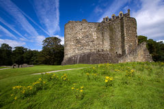 Dunstaffnage Castle. On the north west coast of Scotland near Oban in Argyll and Bute. This monolithic and impregnable-looking fortresss was constructed in the Royalty Free Stock Photo