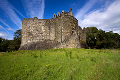Dunstaffnage Castle. On the north west coast of Scotland near Oban in Argyll and Bute. This monolithic and impregnable-looking fortresss was constructed in the Royalty Free Stock Photos
