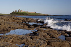 Dunstanburgh Castle. From Craster, Northumberland, UK stock photography