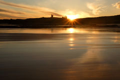 Dunstanburgh Castle. From Low Buston Beach royalty free stock image