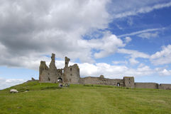 Dunstanburgh Castle. The ruined front of Dunstanburgh Castle, Northumberland royalty free stock photo