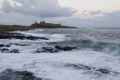 Dunstanburgh Castle and coast Stock Photography