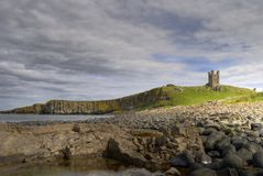 Dunstanburgh Castle and coast Stock Image