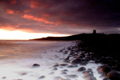 Dunstanburgh Castle coastline Royalty Free Stock Photography