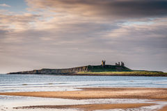 Dunstanburgh Castle from Embleton Bay Royalty Free Stock Photography