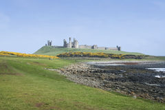 Dunstanburgh castle northumberland coast Royalty Free Stock Images