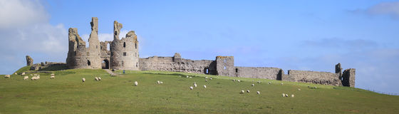 Dunstanburgh castle northumberland coast uk Stock Image