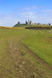 Dunstanburgh castle northumberland coastal path uk Royalty Free Stock Photos