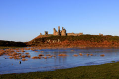 Dunstanburgh Castle. Northumberland, England in winter Royalty Free Stock Photography