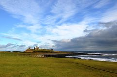 Dunstanburgh castle in Northumberland Stock Image