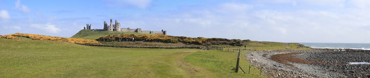 Dunstanburgh castle panorama northumberland coast  Stock Photography