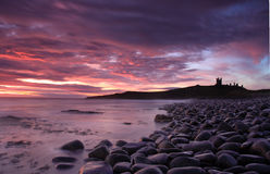 Dunstanburgh castle Sunrise Royalty Free Stock Photography