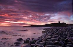 Dunstanburgh castle Sunrise Royalty Free Stock Photography