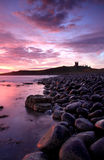 Dunstanburgh castle Sunrise Stock Photo