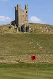 Dunstanburgh Castle Tower and golf course Stock Image