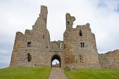 Dunstanburgh kasztel - ruiny zdjęcie stock
