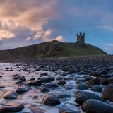 Dunstanburgh-Schloss in Northumberland Lizenzfreies Stockfoto