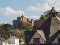 Dunster Yarn Market & Castle, Somerset. The medieval village of Dunster is in Somerset within the Exmoor National Park, England. With it's Castle and roof of the Royalty Free Stock Image