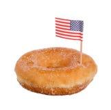 Dunut med amerikanska flaggan Arkivbild