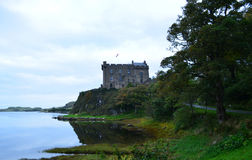 Dunvegan Castle on a Sea Cliff in Scotland Royalty Free Stock Photos