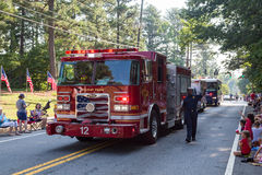 Dunwoody Fire Department in Parade. DUNWOODY, GEORGIA - July 4, 2016: Participants and spectators in the annual Dunwoody, Georgia 4th of July parade which royalty free stock photos